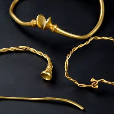 The four iron age gold torcs – three collars and a bracelet-sized piece, including two made of twisted gold wire, two with trumpet shaped finials and one with beautiful Celtic ornament.