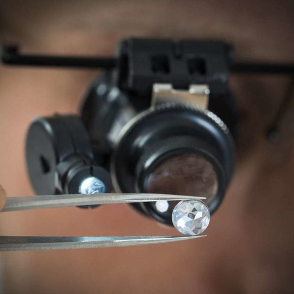 Shutterstock 299702750.jpg This shutterstock image show close-up of person looking at diamond with magnifying loupe.