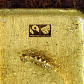 A brick of Fair trade gold with a Fair trade stamp on it.