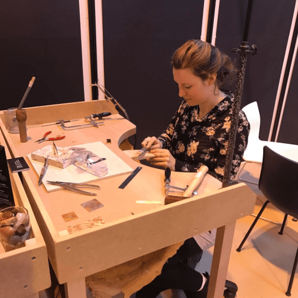 Our tutor Sarah Arnold at a bench at Jewellery & Watch Show