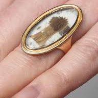 a ring with a lock of hair inside