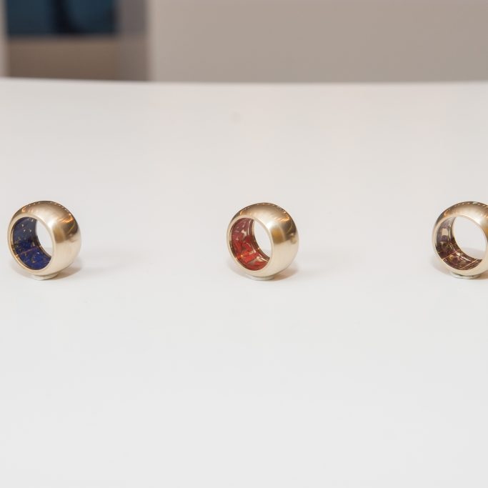 3 rings, clear resin with 3 different materials on the inside